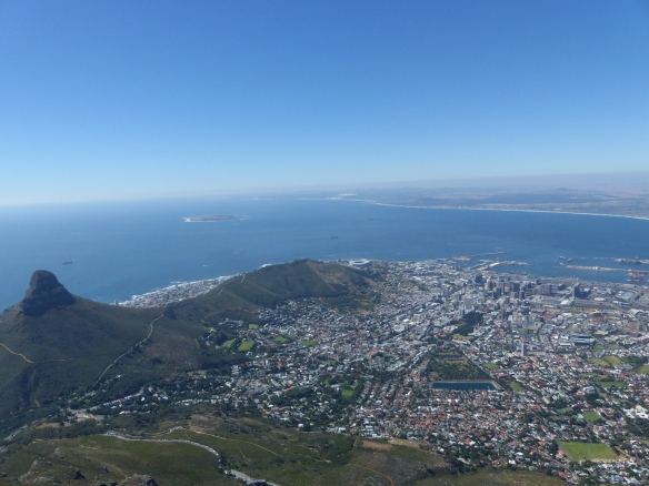 Signal hill with City Bowl and Robben Island in the distance where Nelson Mandela was held in prison.